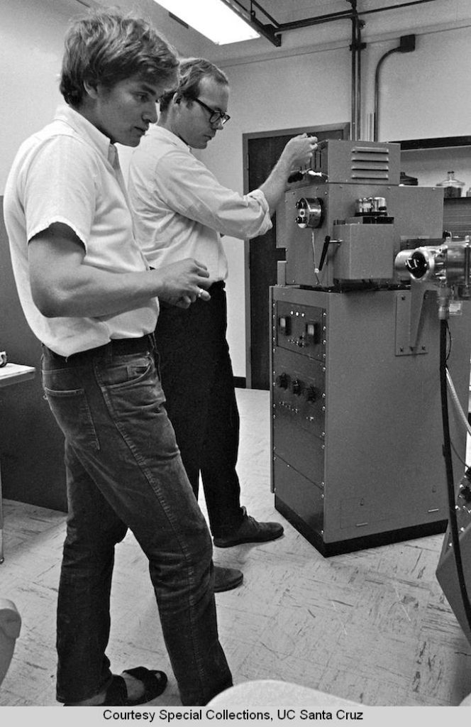 Chemistry_Board_Professor_John_E_McMurry_and_graduate_student_Anthony_Coppolino_BS_1968_Pratt_Institute_examining_the_results_of_a_mass_spectrum